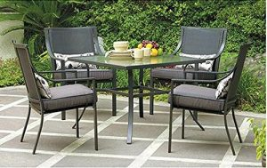 Relax In Your Backyard With The Gramercy Home 5 Piece Patio Dining Table Set.  With 4 Chairs And A Table, There Is Ample Room For Outdoor Dining.